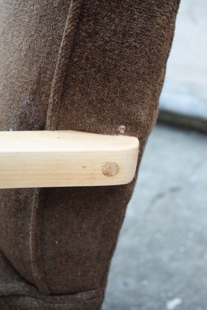 closeup of joints that connects the armrest to the chair