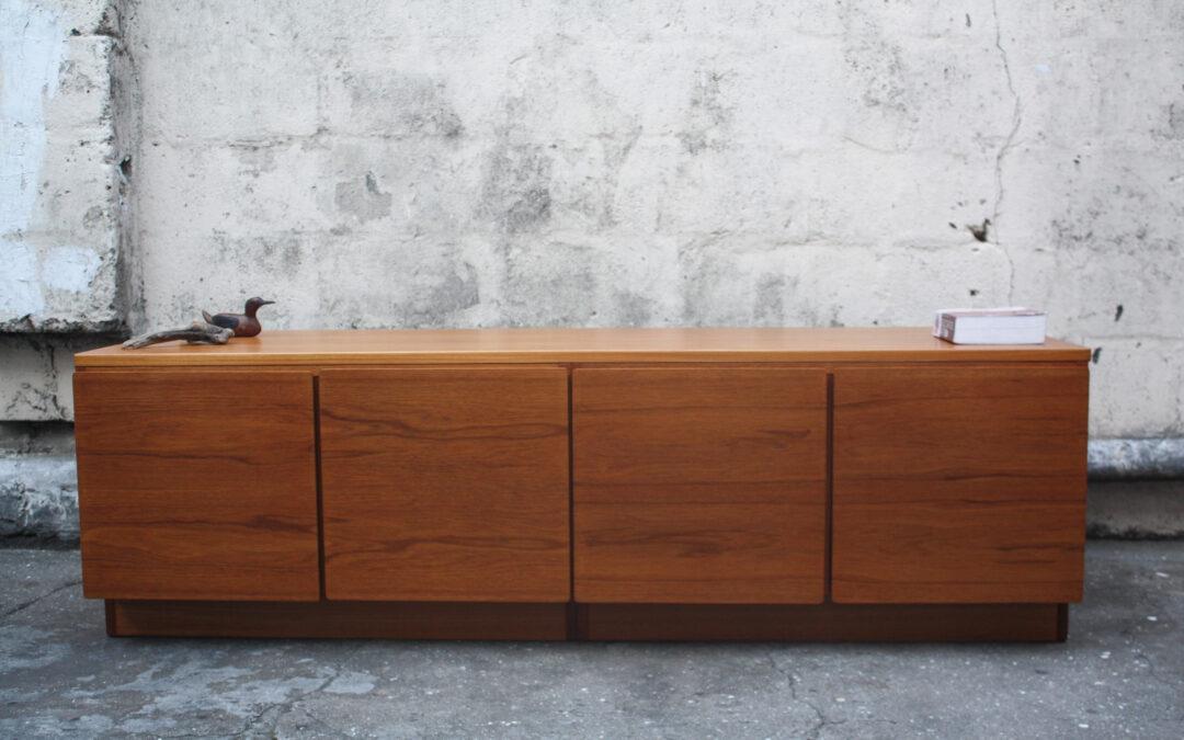 Exquisite low sunk Teak Mid century sideboard cabinet. Sold