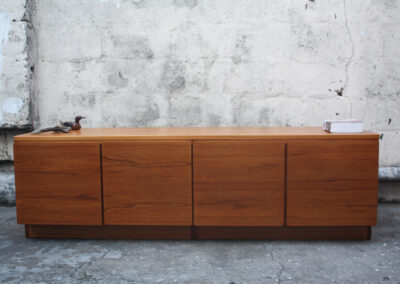 Exquisite low sunk Teak Mid century sideboard cabinet. Sale for R6500